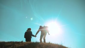 Happy family teamwork business travel concept. couple silhouette jump happiness husband and wife run holding hands. Tourists. man and girl hikers tourists stock footage