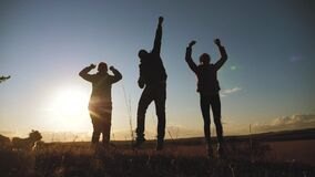 Happy family teamwork silhouette jumping for joy and happiness. concept success victory in business goal achievement. a