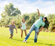 Happy family with teenager  playing in soccer Stock Images