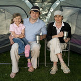 Happy family in tent Stock Images