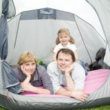 Happy family in tent Royalty Free Stock Photos