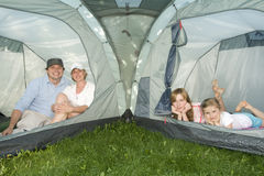 Happy family in tent Stock Photos