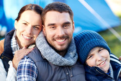 Happy family with tent at camp site Royalty Free Stock Photos