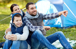 Happy family with tent at camp site Royalty Free Stock Image