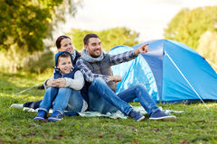 Happy family with tent at camp site Royalty Free Stock Images