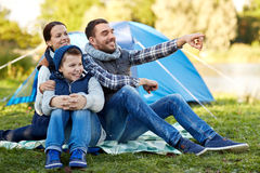Happy family with tent at camp site Royalty Free Stock Photo