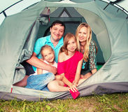 Happy family in a tent Stock Image
