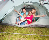 Happy family in a tent Stock Photography