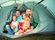 Happy family in a tent Royalty Free Stock Images