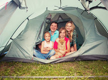 Happy family in a tent Royalty Free Stock Photography