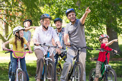 Happy family on their bike at the park Stock Images