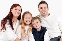 Happy family with their children Stock Photos