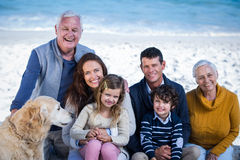 Happy family with their dog at the beach Stock Image