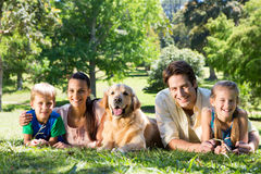 Happy family with their dog in the park Royalty Free Stock Images