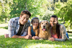 Happy family with their dog in the park Royalty Free Stock Image