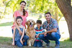 Happy family with their dog in the park Royalty Free Stock Photos