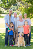 Happy family with their dog smiling to camera Stock Photography