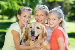 Happy family with their dog Stock Photography