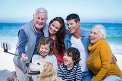 Happy family with their dog taking a selfie Royalty Free Stock Images