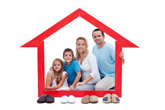 Happy family in their home concept. With slippers aligned in front royalty free stock images