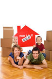 Happy family in their new home Stock Photo