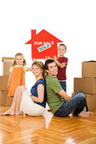Happy family in their new home Stock Images