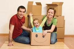 Happy family in their new home stock photography