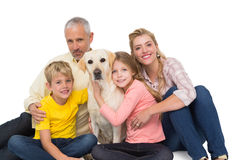 Happy family with their pet dog Royalty Free Stock Image