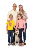 Happy family with their pet dog Stock Photos