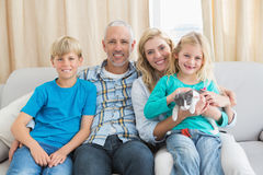 Happy family with their pet kitten Royalty Free Stock Images