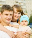 Happy family of three Royalty Free Stock Photography