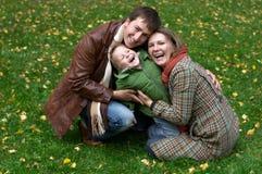 Happy family of three Stock Photos