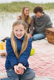Happy family of three at a beach picnic Stock Photography