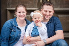 Happy Family of Three in Blue and white Stock Images