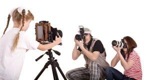 Happy family with three camera. Stock Image