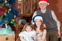 Happy family of three celebrating Christmas Royalty Free Stock Photo