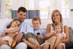Happy family with three children at home stock photos