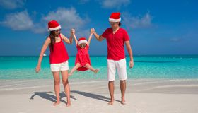 Happy family of three in Christmas Hats having fun Royalty Free Stock Images