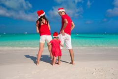 Happy family of three in Christmas Hats during Stock Photo