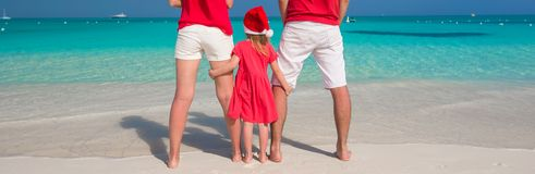 Happy family of three in Christmas Hats during Royalty Free Stock Photo