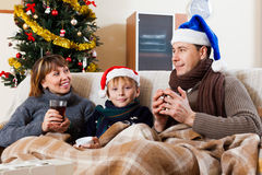 Happy family of three in Christmas time Royalty Free Stock Image