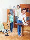 Happy family of three   cleaning in home Stock Photo