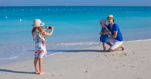 Happy family of three enjoying beach vacation Royalty Free Stock Image