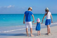 Happy family of three enjoying beach vacation Stock Photos