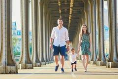 Happy family of three enjoying their vacation in Paris Royalty Free Stock Photo
