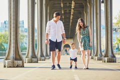 Happy family of three enjoying their vacation in Paris Royalty Free Stock Image