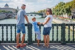 Happy family of three enjoying vacation in Paris, France royalty free stock photos