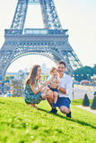 Happy family of three enjoying their vacation in Paris Royalty Free Stock Images