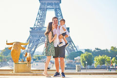 Happy family of three enjoying their vacation in Paris Stock Images