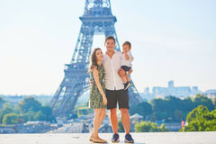 Happy family of three enjoying their vacation in Paris Stock Photography